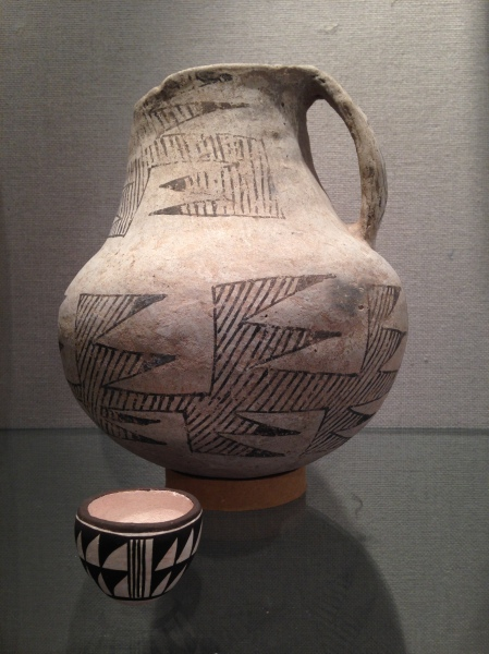 This pitcher and small cup, both with white & black geometric designs, is from the Anasazi of the Colorado Plateau, circa 950-1250 CE.